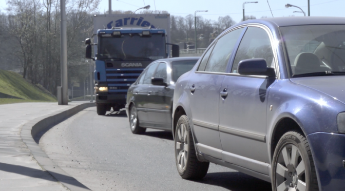 Škoda Fabia, Ford Transit, Scania are pass passing by slowly. Free HD video footage