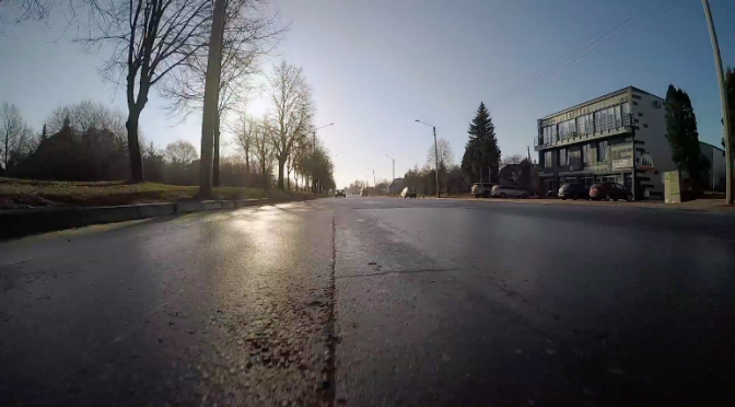 A cam fixed to the running car's hook & hitch equipment captures sunset. GoPro HD video footage