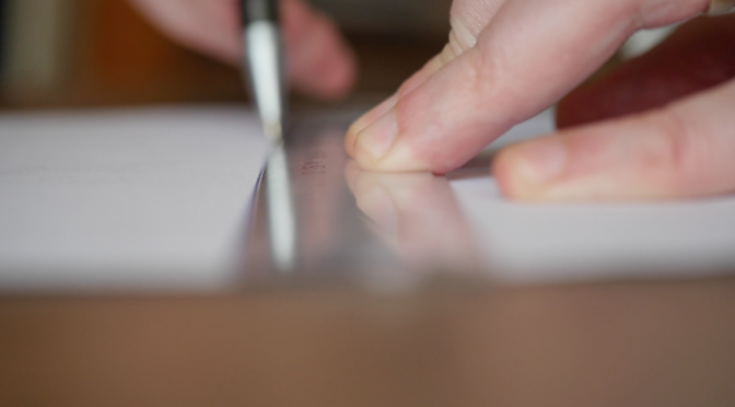 Drawing a line using a ruler and a ball point. Free HD video footage