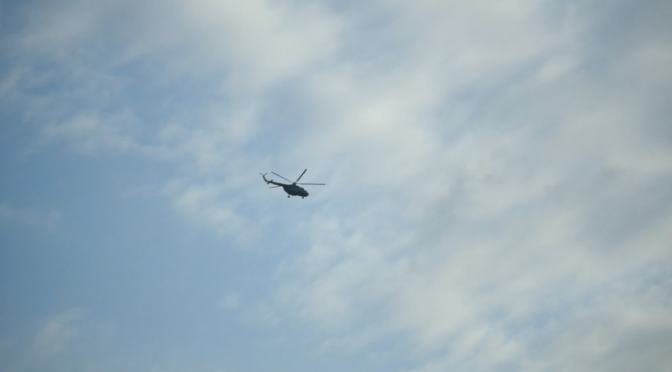 Helicopter scrolls cloudy and vespertine sky. Free HD video footage