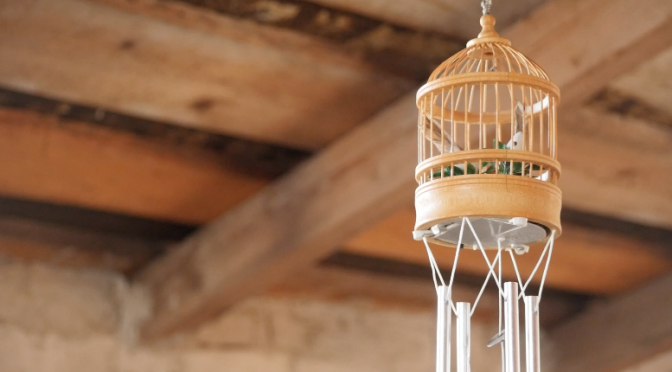 Modern version of an indian wind chimes hanging on the ceiling of a loft. Free HD video footage