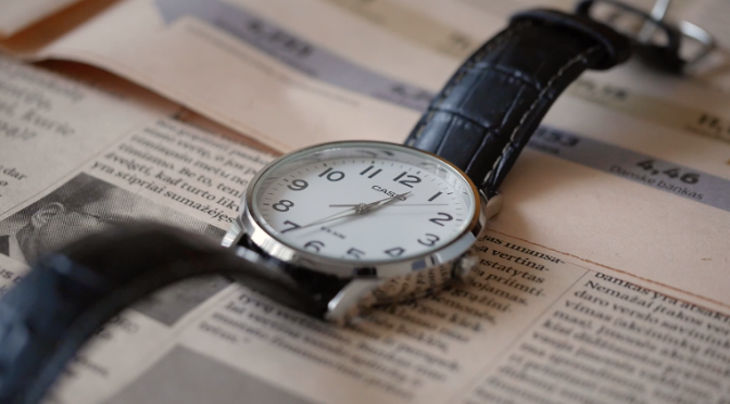 A leather arm watch is ticking on a business newspaper. Free HD video footage