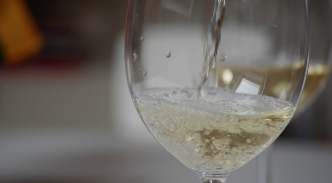 White wine pouring into a glass. Free HD slow motion video footage