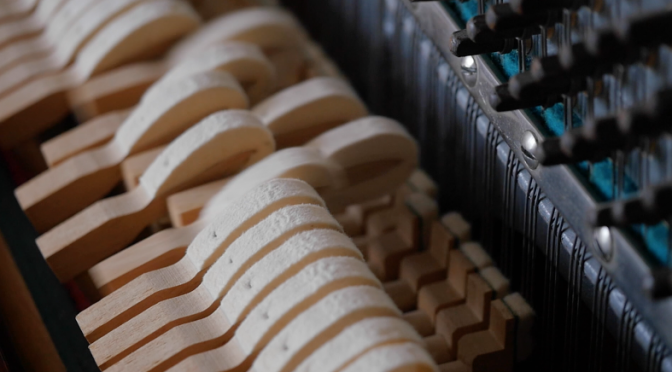 Piano hammers hitting the strings in slow motion. Free HD video footage