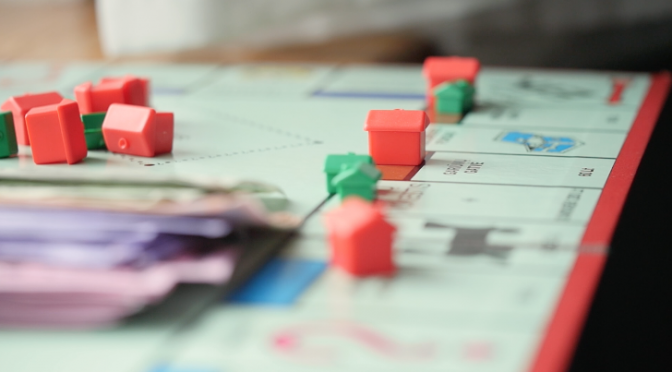 Buying and trading properties in a board game Monopoly. Free HD video footage