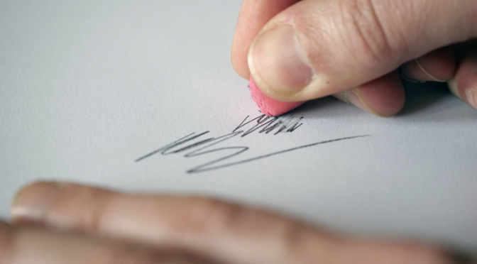 Erasing pencil scribbles with a rubber. Free HD video footage