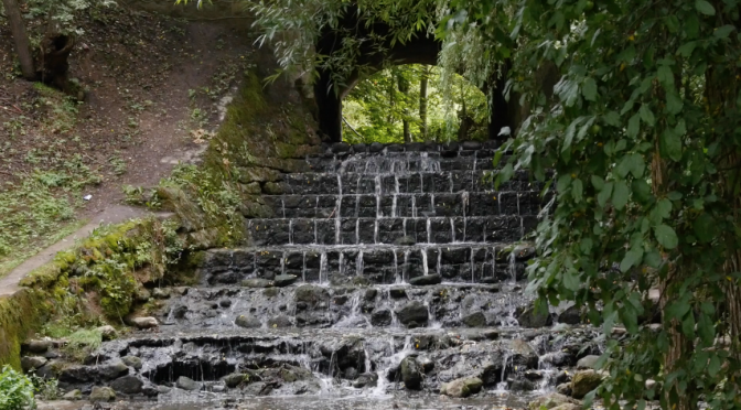 Waterfall and an artificial cascade. Free HD video footage