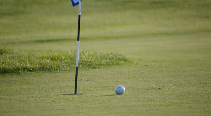 A missed golf shot. A ball stops near the hole. Free HD video footage