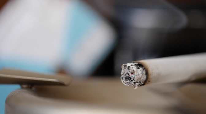 A cigarette in an ashtray. Free HD video footage
