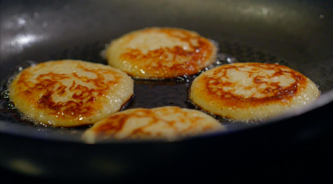 Frying pancakes in a pan. Free HD video footage