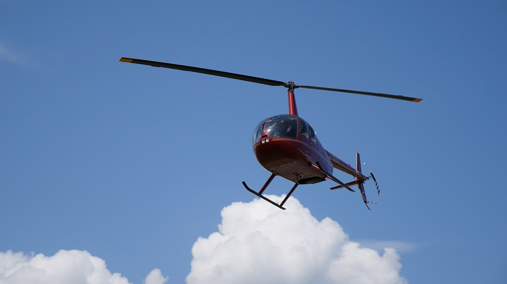 Helicopter performs in airplane show