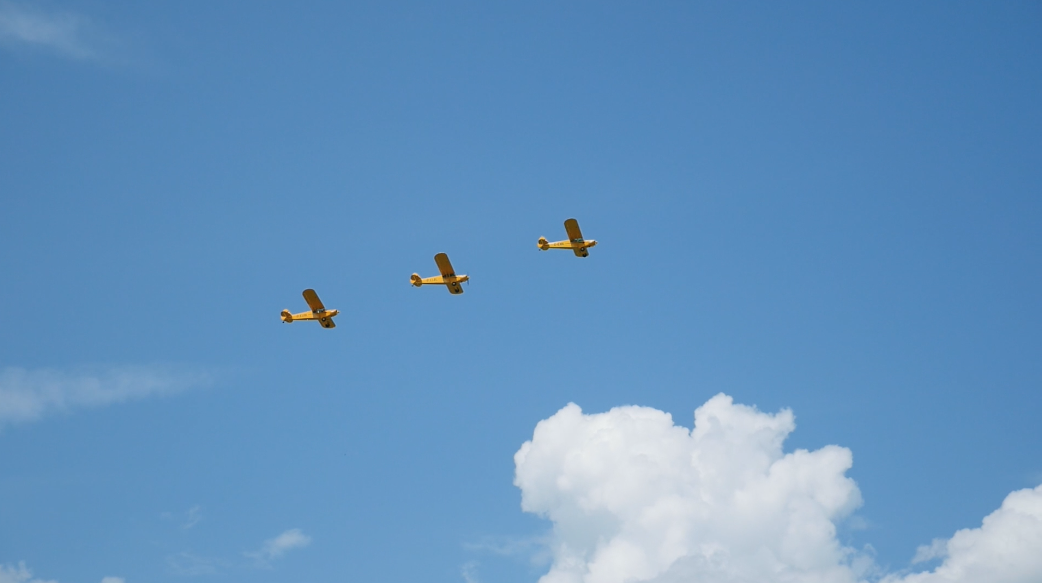 Three ultralight aircrafts flying in a row. Free HD video footage