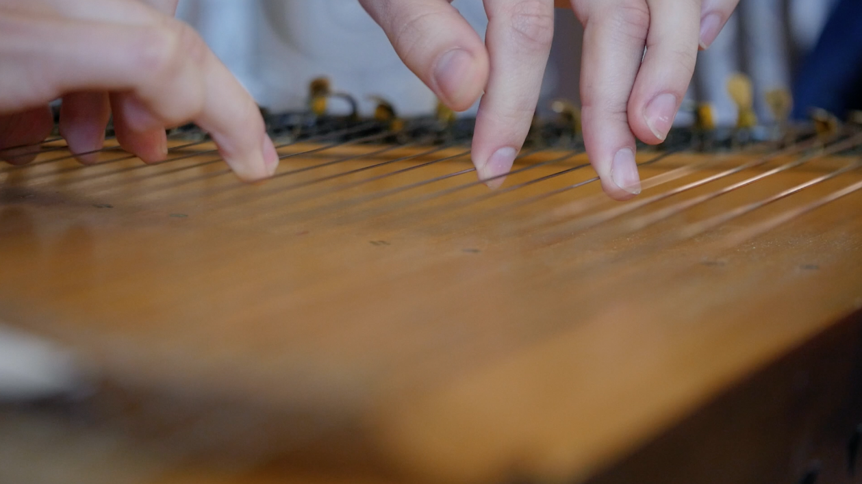 playing-the-ethnic-zither-instrument-free-hd-video-footage
