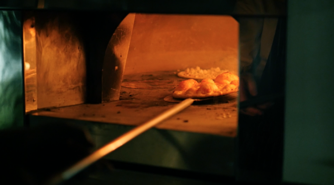 Baking wood fired pizza. Free HD video footage