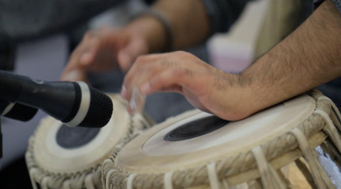 Hindi musician is playing with tabla percussion. Free HD video footage