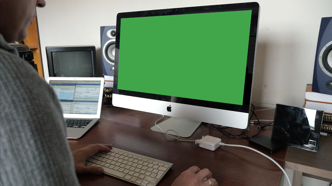 Man using computer with green screen display. Free stock footage